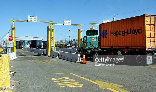 Tractor trailer drives through a radiation portal monitor as it leaves the docks March 22, 2004 in Jersey City, New Jersey. U.S. Customs and Border...