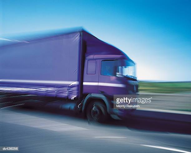 Tractor trailer driving on road