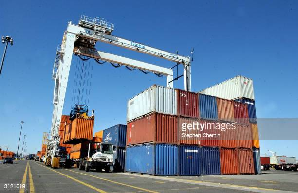 Tractor trailer has it's shipping container lifted for storage and examination at the docks March 22, 2004 in Jersey City, New Jersey. U.S. Customs...