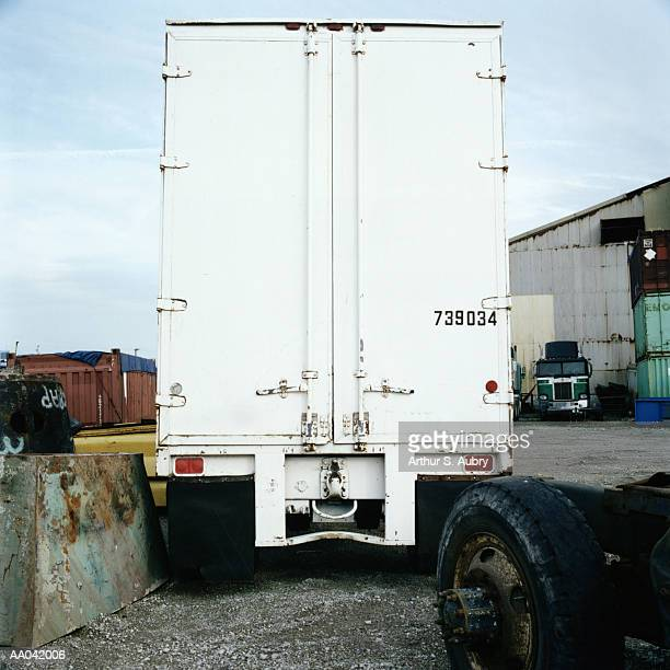 Tractor trailer in industrial area, rear view