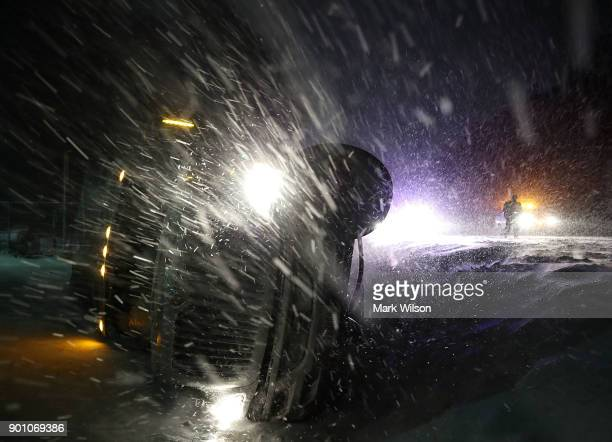 A tractor trailer lays on its side after running off of he road during a snow storm on January 4 2018 in Georgetown Delaware A winter storm is...