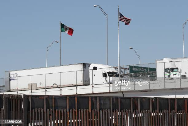 Tractor trailer trucks are seen heading into the United States from Mexico along the Bridge of the Americas on June 04, 2019 in El Paso, Texas. U.S....