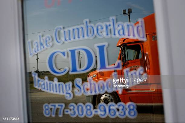 A tractor trailer used for training and student instruction is reflected in the window during a commercial drivers license class at Lake Cumberland...