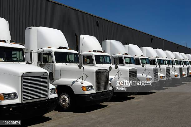 tractor trailers in line - trucking stock pictures, royalty-free photos & images