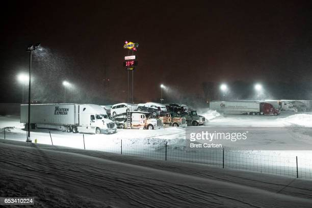 Tractor trailers stop for the night at a gas station off route 86 after snow covered most of the northeast on March 14 2017 in Athens Pennsylvania A...