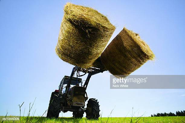 Tractor Transporting Bales of Hay