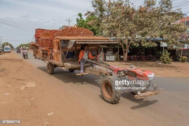 Tractor transporting furniture in Cambodia.