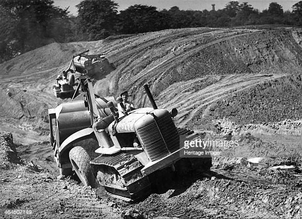Tractor unit pulling an earth grading machine at a site near Rotherham South Yorkshire 1954 The AllisChalmers HD10W Tractor/Bulldozer was introduced...