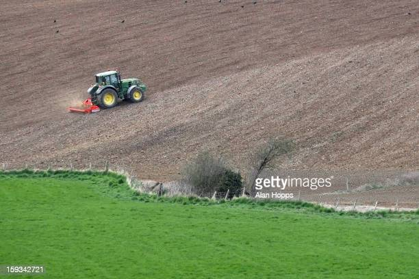 CONTENT] A tractor using a power harrow to create a seed bed for spring barley near Markethill County Armagh Northern Ireland Taken on 20/4/2010