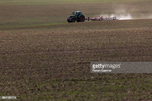 A tractor with a cultivator is pictured on a field on April 30 2018 in Kunnerwitz Germany