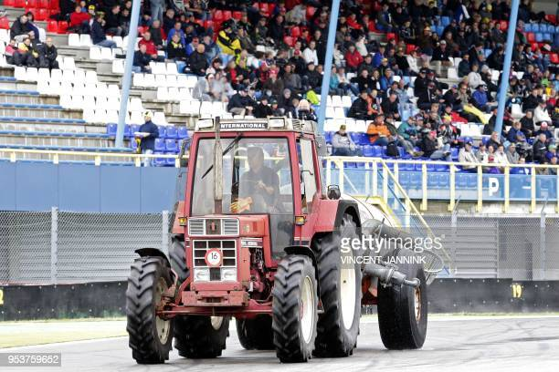 A tractor with a manure tank crosses the TT circuit in Assen to remove the oil spill due to a crash of Italy's Alex Baldoliniin in Assen The...