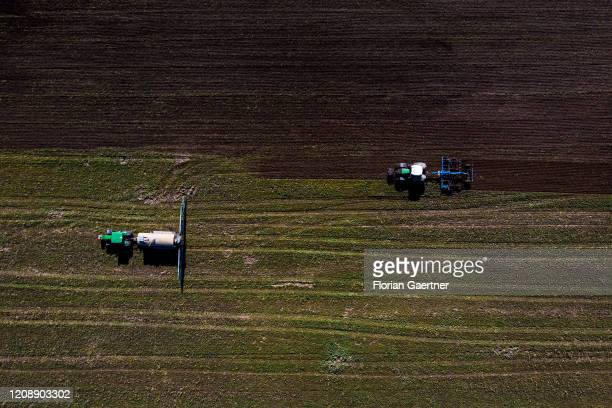 A tractor with liquid manure and a tractor with cultivator are pictured on September 14 2017 in Torga Germany