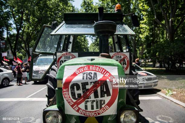 A tractor with placards against CETA trade deal during a demonstration demanding Spanish government not to ratify trade agreement between Canada and...