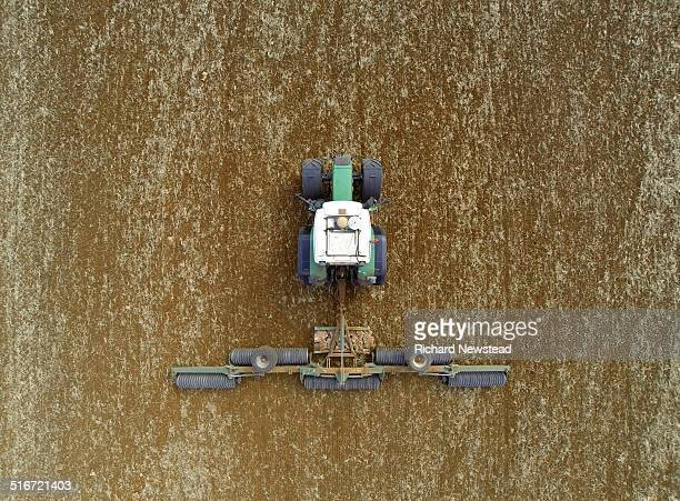 tractor with plough - tractor stock pictures, royalty-free photos & images