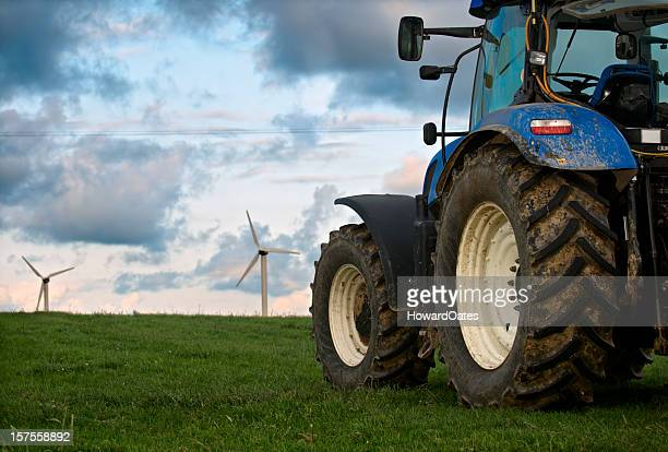 Tractor with wind farm turbines in Cornwall