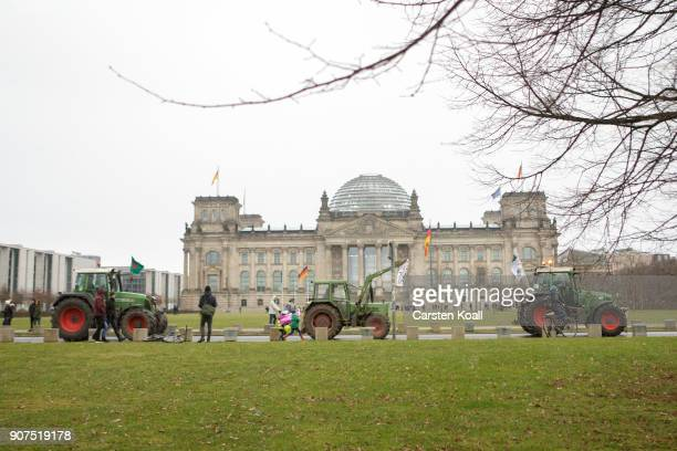 Tractors are driven in front of the Reichstagsbuilding the seat of the german parliament during a march against the agroindustry on January 20 2018...