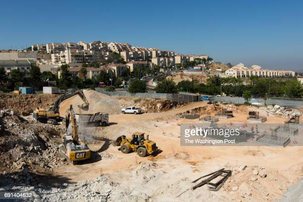 Tractors are seen at the construction site of a new medical school and center in Ariel University at the West Bank Jewish settlement of Ariel located...