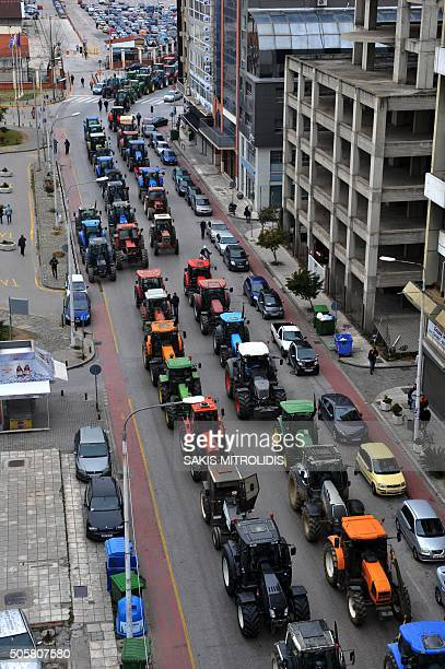 Tractors block traffic on a street in downtown Thessaloniki on January 20 2016 as Greek farmers protest a controversial pension reform planned by the...