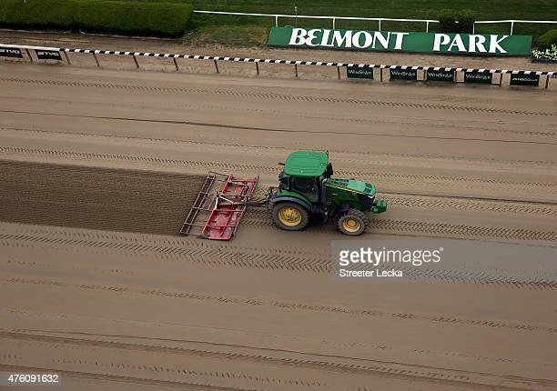 Tractors harrow the track during the 147th running of the Belmont Stakes at Belmont Park on June 6 2015 in Elmont New York