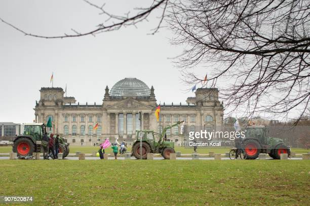 Tractors passing by the Reichstagsbuilding the seat of the german parliament during a march to demonstrate against the agroindustry on January 20...