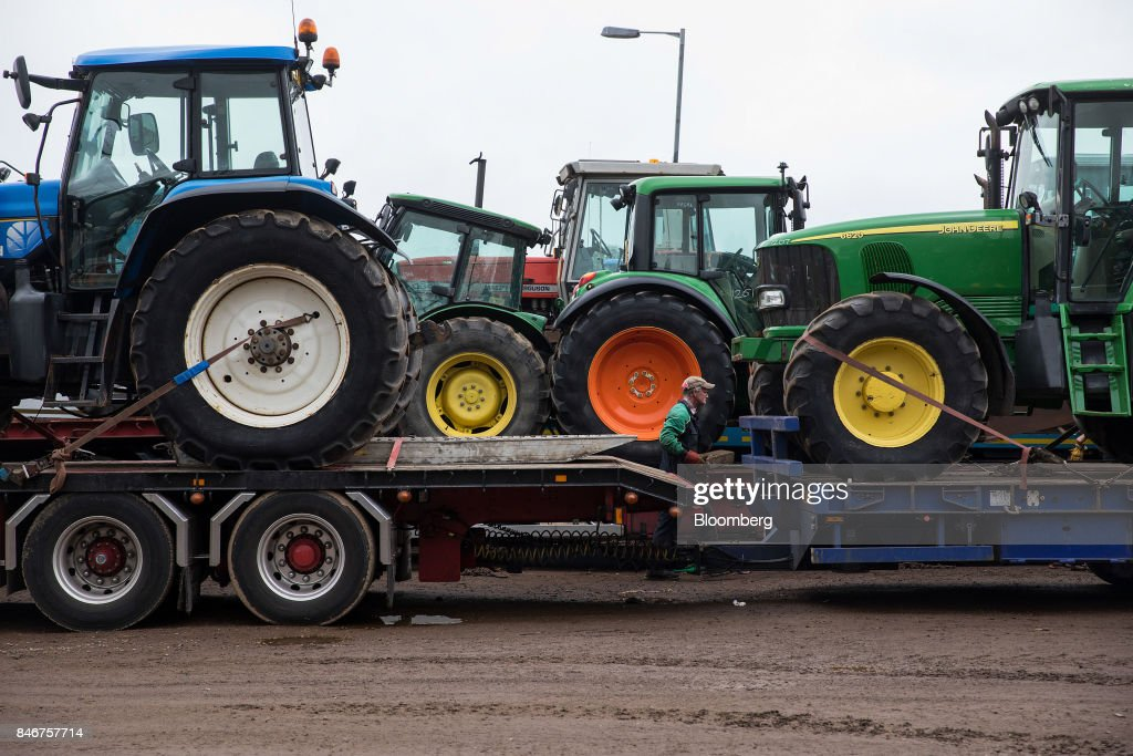 Tractors purchased at auction are loaded onto a low-loader truck at the Cheffins Cambridge Machinery Sales monthly machinery and plant auction in Sutton, U.K., on Monday, Sept. 4, 2017. The debate over food andfarmingpolicy after Brexit has heated up recently, with Environment Secretary Michael Gove telling BBC Radio 4 that the U.K wouldnt lower its animal welfare or environmental standards to achieve any new trade deals. Photographer: Simon Dawson/Bloomberg via Getty Images