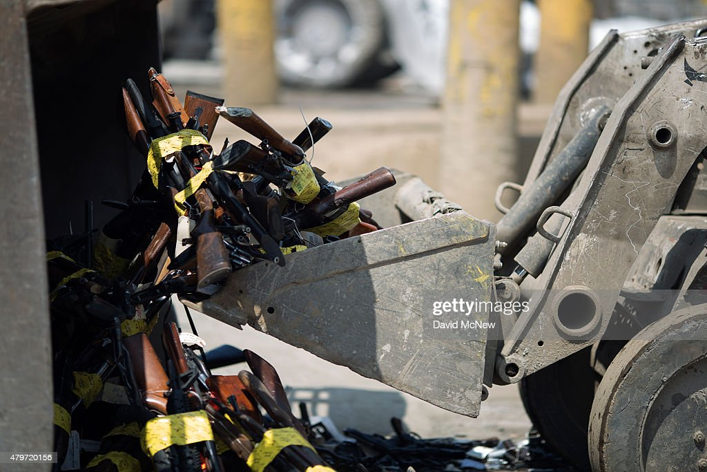 Tractors scoop up guns during the destruction of approximately 3,400 guns and other weapons at the Los Angeles County Sheriffs' 22nd annual gun melt at Gerdau Steel Mill on July 6, 2015 in Rancho Cucamonga, California. The weapons, confiscated in various law enforcement operations, will be recycled in the form of steel rebar to be used in construction. California law requires the destruction of the confiscated weapons.