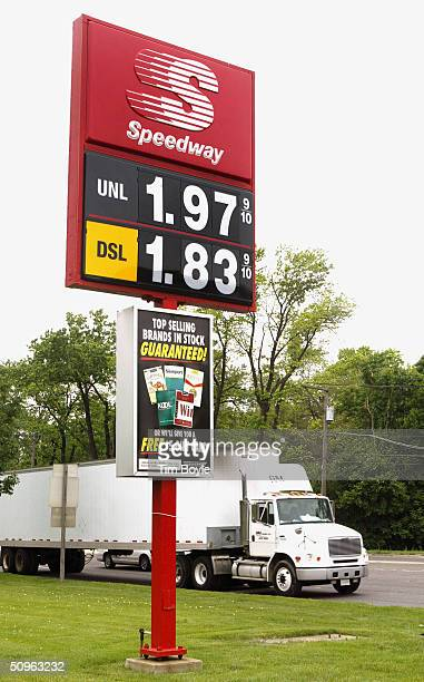 A tractortrailer drives past displayed unleaded gasoline and diesel fuel prices at a Speedway gas station June 15 2004 in Des Plaines Illinois In...
