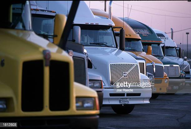 Tractortrailer rigs are parked at the Petro truck stop May 29 2000in El Paso TX Many of the rigs now have modern wireless communications as well as...