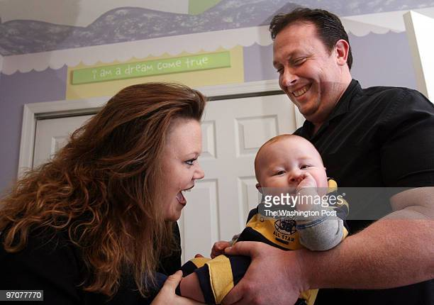 Tracy A Woodward/The Washington Post Hubbard Court Stafford VA GarField football coach Joe Mangano wife Heather and son Jake 5 1/2 months old Heather...