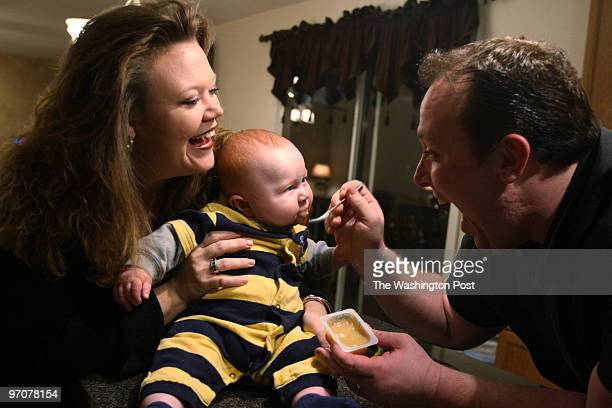 Tracy A Woodward/The Washington Post Hubbard Court Stafford VA GarField football coach Joe Mangano wife Heather and son Jake 5 1/2 months old Heather...