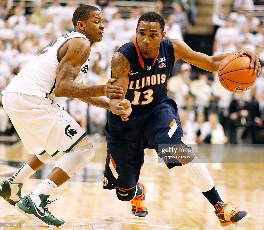 Tracy Abrams #13 of the Illinois Fighting Illini drives around Keith Appling #11 of the Michigan State Spartans during the second half at the Jack T. Breslin Student Events Center on January 31, 2013 in East Lansing, Michigan. Michigan State won the game 80-75.