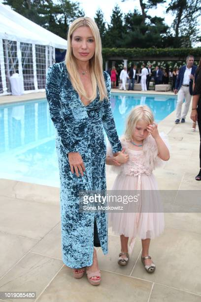 Tracy Anderson and daughter Penelope Mogol attend an Intimate Evening Under the Stars with Michael Bolton on August 18 2018 in Water Mill New York
