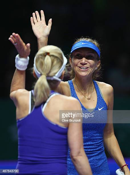 Tracy Austin of the United States and Iva Majoli of Croatia celebrate a against Martina Navratilova of the United States and Marion Bartoli of France...