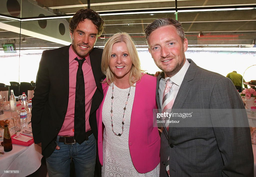 Tracy Bevan (C), McGrath Foundation ambassador and Director poses with Stephen Curry (R) and Damon Gameau during the 'High Tea at the G' luncheon on day two of the International Test match between Australia and Sri Lanka at Melbourne Cricket Ground on December 27, 2012 in Melbourne, Australia.