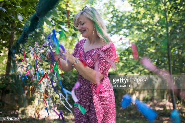 Tracy Brabin the MP for Batley and Spen symbolically ties a ribbon onto a piece of netting during a 'Great Get Together' community service and picnic...