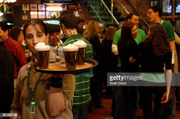 Tracy Dazzo serves Irish coffee to revelers celebrating St Patrick's Day at O'Brien's Restaurant Bar March 17 2008 in Chicago Illinois Chicagoans...