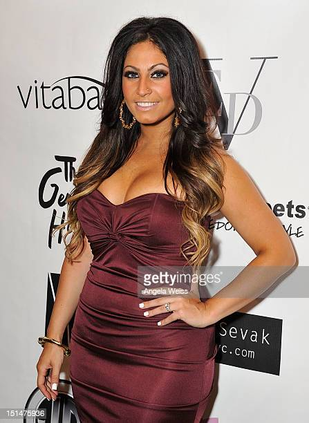Tracy DiMarco attends the Elena V Designs capsule collection spring 2013 presentation during MercedesBenz Fashion Week at the Gershwin Hotel on...