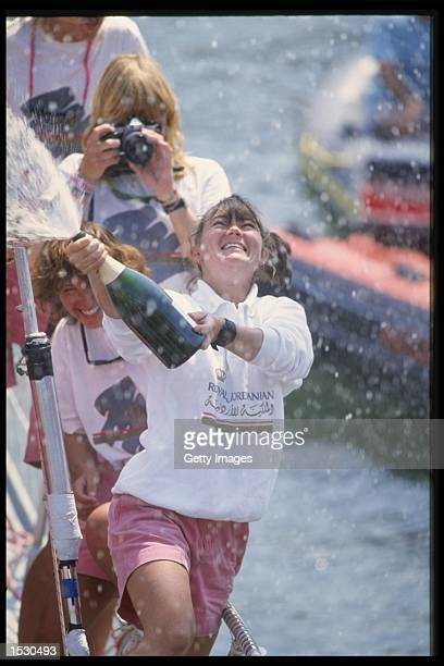 Tracy Edwards the skipper of Maiden celebrates with champagne after finishing second during the Whitbread round the world yacht race Mandatory Credit...