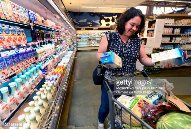 Tracy Eliasson adds two cartons of almond milk to her cart in Alfalfa's Market in Boulder Colorado on Thursday August 2 2018 The US Food and Drug...