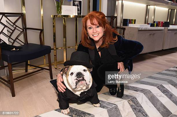Tracy Griffith and Howard the Winston Churchill dog attend Smythson's Madison Avenue Grand Opening Event on March 14 2016 in New York City
