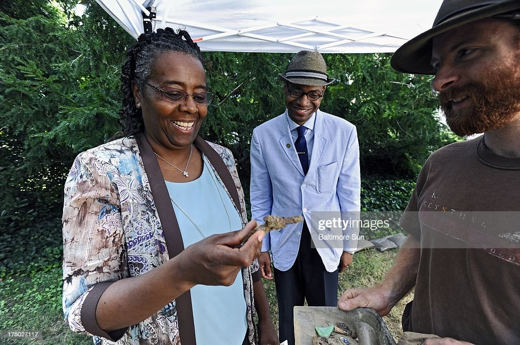 Tracy Jenkins, right, assistant site supervisor, shows an early 20th century toy gun dug from 'The Hill' site, to Carlene Phoenix, left, president of Historical Easton Inc., a sponsor of the archaeological dig, and Dale Green, a Morgan State professor, of architecture and historical preservation, July 24, 2013, in Easton, Maryland.