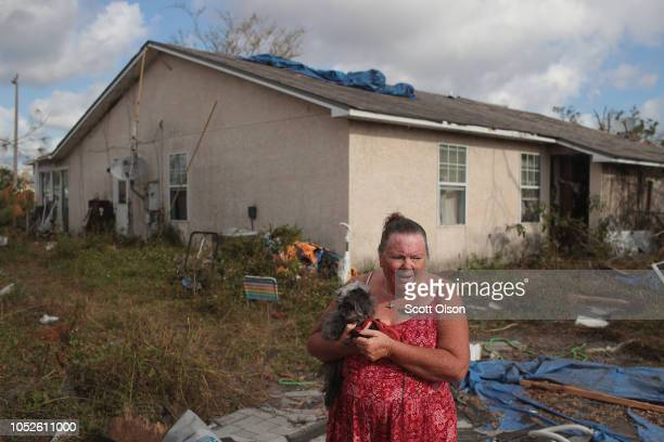 Tracy Lachance standsin the back yard of her home which she believes was damaged beyond repair when Hurricane Michael passed through on October 20...