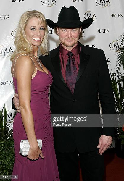 Tracy Lawrence and his wife Becca Lawrence arrive at the 38th Annual CMA Awards at the Grand Ole Opry House November 9 2004 in Nashville Tennessee