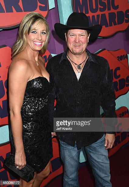 Tracy Lawrence and wife Becca attend the 2014 CMT Music awards at the Bridgestone Arena on June 4 2014 in Nashville Tennessee