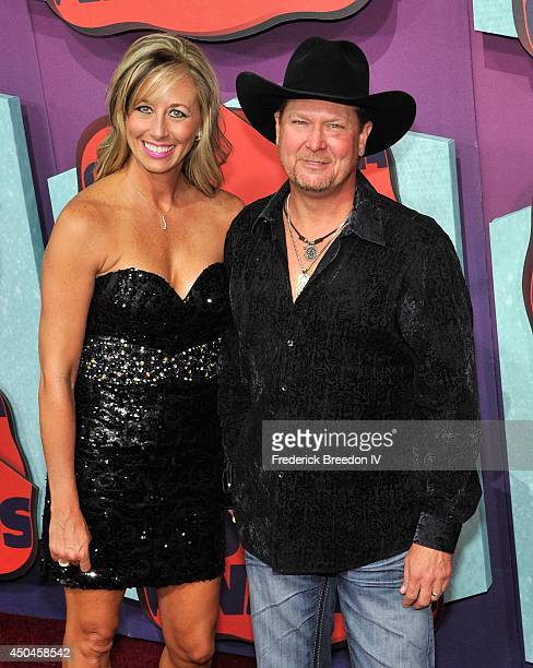 Tracy Lawrence and wife Becca attend the red carpet at the 2014 CMT Music awards at the Bridgestone Arena on June 4 2014 in Nashville Tennessee