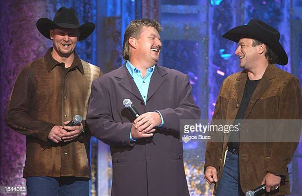 Tracy Lawrence, left, Joe Diffie, center, and Mark Chesnutt onstage during the 37th Annual Academy of Country Music Awards May 22, 2002 at the...