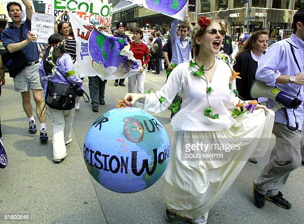 Tracy Lerman of New York leads about 100 environmentalists in a march from Times Square to a park the United Nations in New York as part of Earth Day...