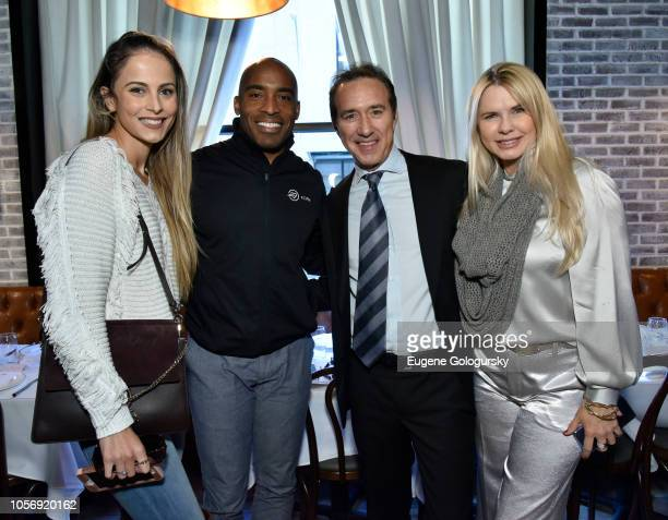 Tracy Lynn Johnson Tiki Barber Michelle Judd and Ian Reisner attend the Amber And CC Sabathia Cheer On Team 52 Marathon With Haute Living Residences...