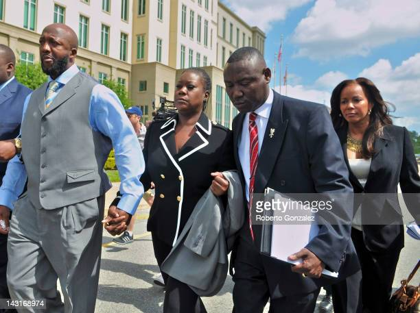 Tracy Martin and Sybrina Fulton, parents of Trayvon Martin, their attorney Benjamin Crump and attorney Natalie Jackson leave Seminole County...