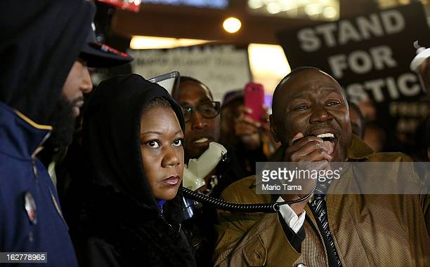 Tracy Martin and Sybrina Fulton Trayvon Martin's parents look on as attorney Benjamin Crump speaks at a candlelight vigil for Martin in Union Square...